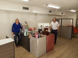 Sarah Ashton and Chris Kirchner, Ashton Kirchner Group of Keller Williams Realty, collects toys for FISH of Sanibel Captiva toy drive