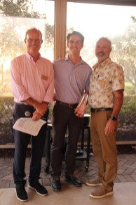 Josh Stewart (center) receives the Sue Rosica Gray Volunteer of the Year Award from past chair Brian Kautz (left) and incoming chair Mark Blust (right).