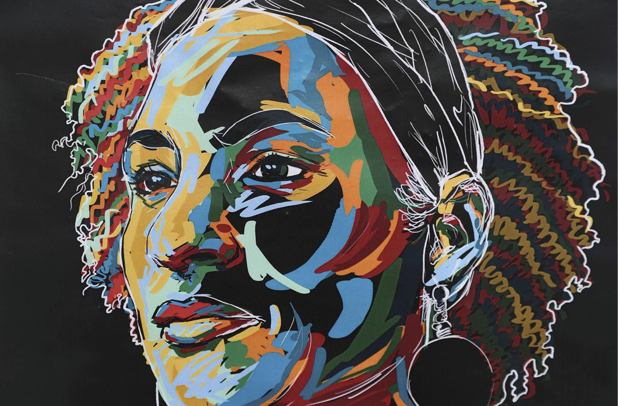 Retrato artístico da vereadora brasileira Marielle Franco pintado na parede onde foi assassinada, no Rio de Janeiro, a 20 de março de 2018. EPA / MARCELO SAYAO
