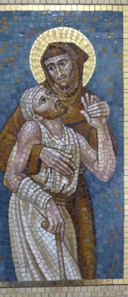 São Francisco e o leproso. Mosaico na Cúria Geral da OFM (foto de Jim McIntosh, wikimedia.org).