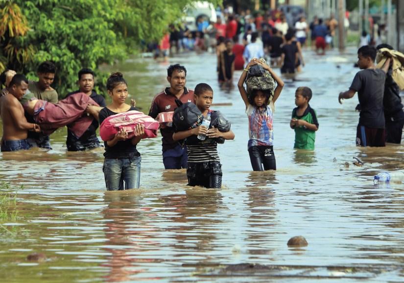 Inundações em Tasitolu, Dili, Timor Leste, 23 de janeiro de 2020. Foto EPA / ANTONIO DASIPARU