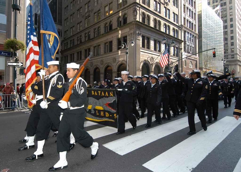 081111-N-2636M-173 NEW YORK (Nov. 11, 2008) Sailors from the multi-purpose amphibious assault ship USS Bataan (LHD 5) march and wave to parade onlookers during New York's annual Veterans Day parade. Bataan is in New York for a week of community relation projects, daily tours, participating in the city's annual Veterans Day Parade and support for the reopening of the Intrepid Sea, Air & Space Museum. (U.S. Navy photo by Mass Communication Specialist 3rd Class Kleynia R. McKnight/Released)