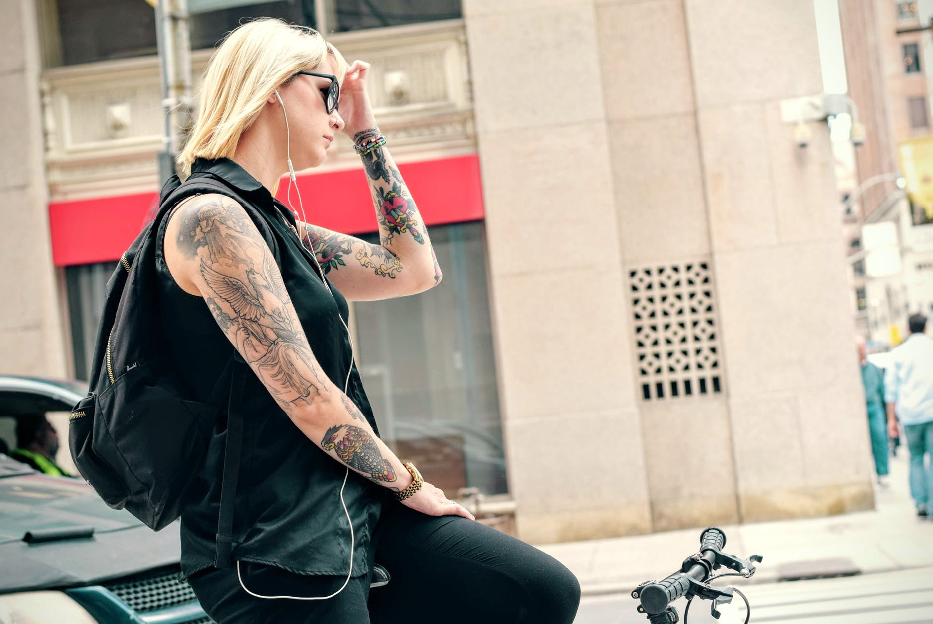 """Photo by Tim Gouw on <a href=""""https://www.pexels.com/photo/tattoos-bike-cycle-girl-26138/"""" rel=""""nofollow"""">Pexels.com</a>"""