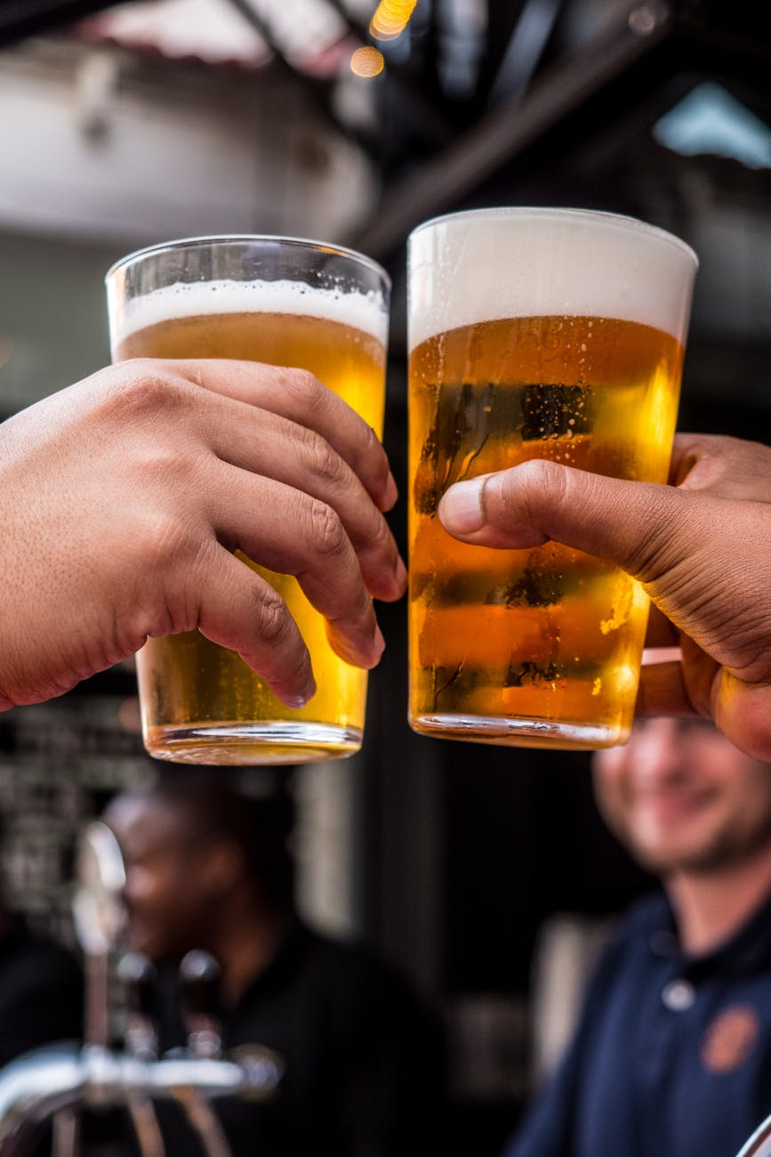 "Photo by Tembela Bohle on <a href=""https://www.pexels.com/photo/two-persons-holding-drinking-glasses-filled-with-beer-1089930/"" rel=""nofollow"">Pexels.com</a>"