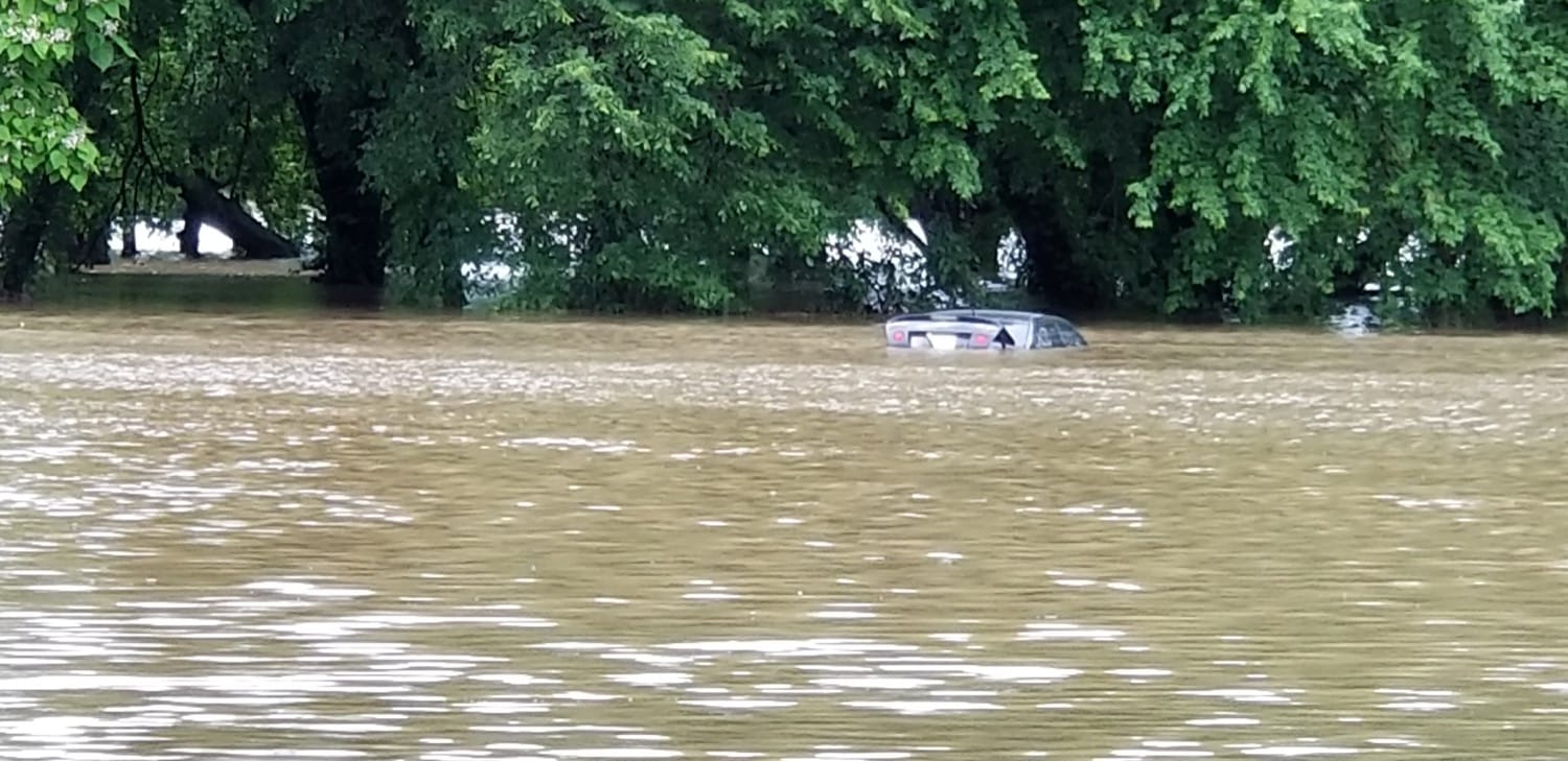 A submerged vehicle on South Hickory as viewed from West Davis street. Photo by Charles Betzler.
