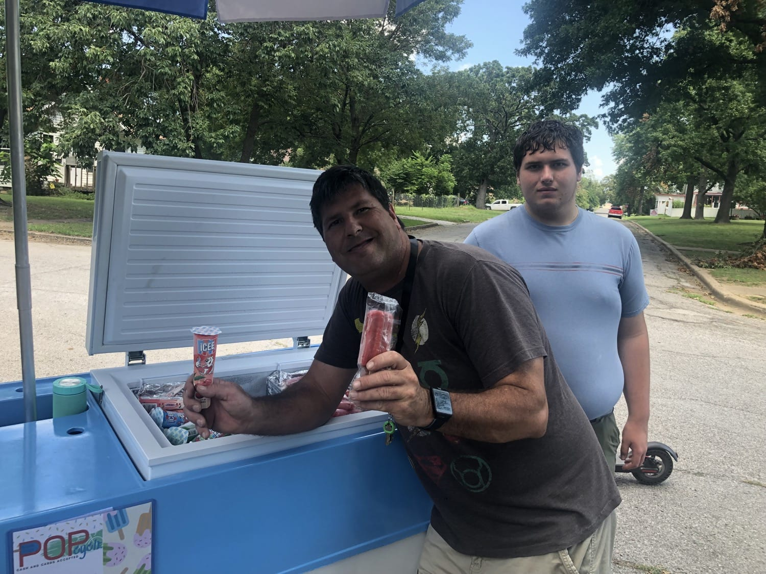Frederic Moseley Jr. stands with his son Jeremy as he shows off treats at his new Popcycle, which he says is Oklahoma's only one.