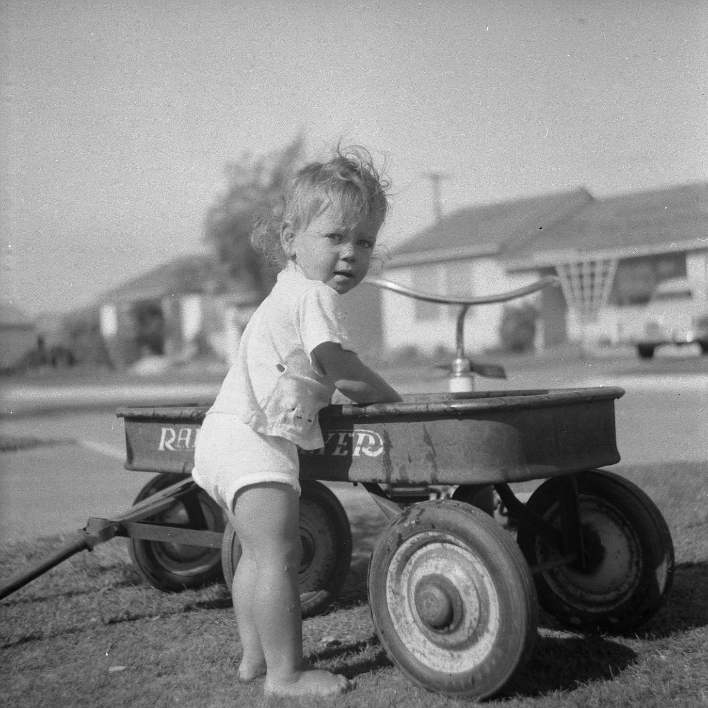 Young girl with Radio Flyer wagon circa 1955.