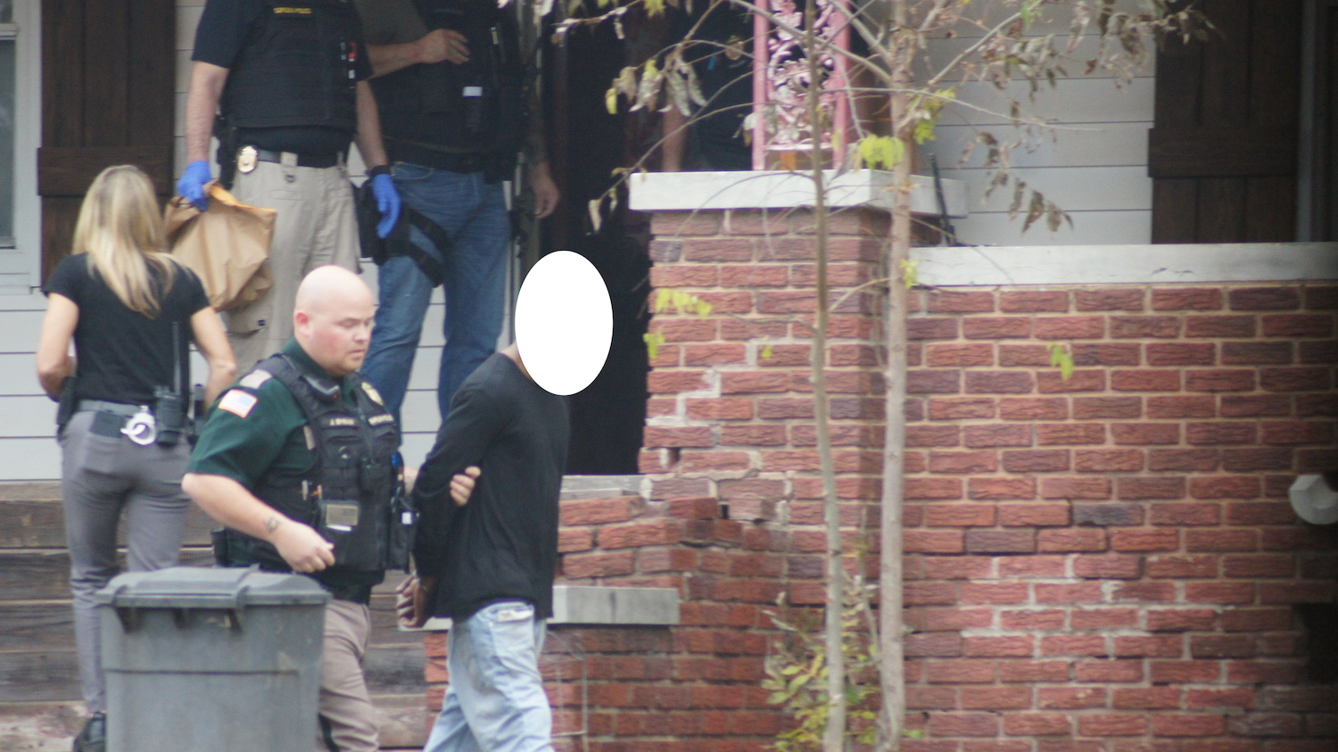 An individual is arrested as part of a warrant sweep this week. Photo by Daryl Howard for Sapulpa Times.