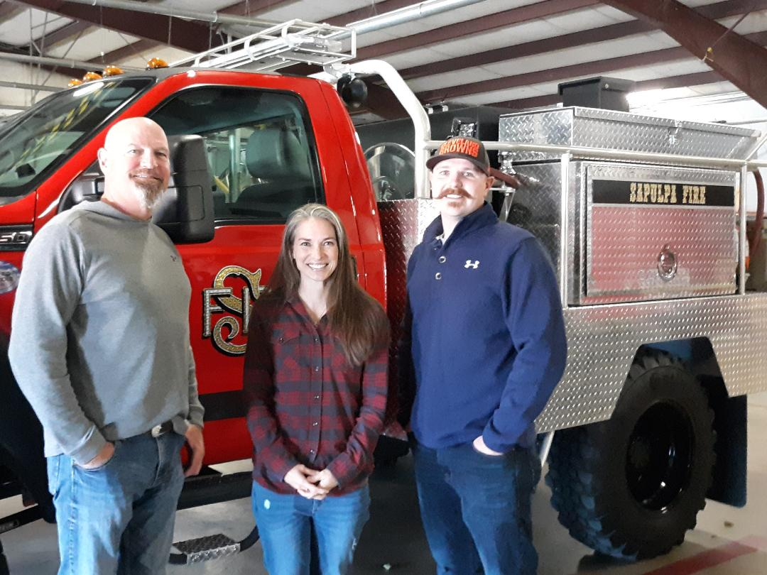 Retired Sapulpa Fireman Steve Fleak, left, stands with Brooke and Paden Fleak, who is following in his father's footsteps with the SFD.