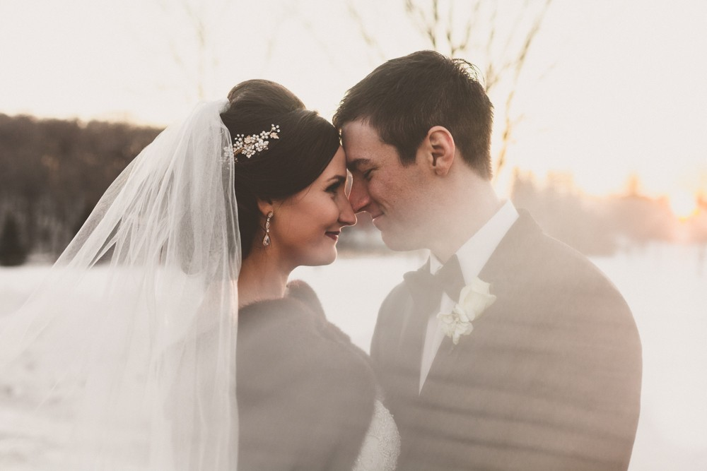 Gold glam winter New Year's Eve wedding in Decorah, Iowa photographed by Sara Anne Johnson