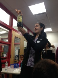 Julia holding up a homemade lava lamp, which was one of the activities we did at the Girls Science Club I coordinate at the local Boys and Girls Club.