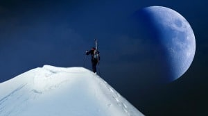 Sara Grillo - Man hiking a mountain moonrise
