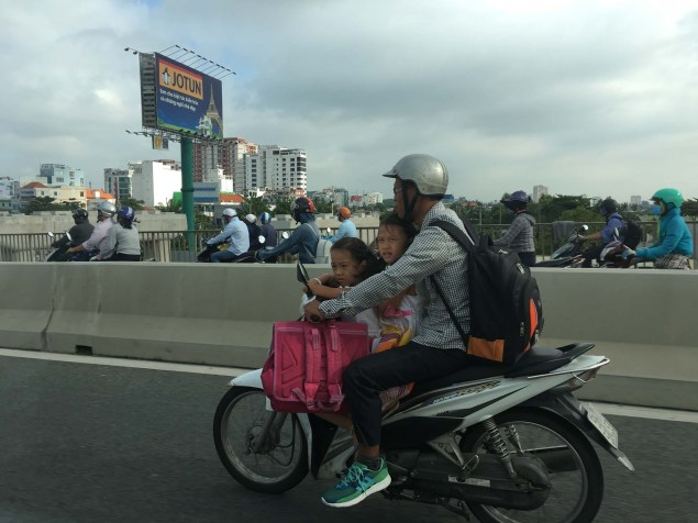 The children seem much more comfortable than me on the bikes. The government has enforced helmet-wearing to help with the high traffic mortality rate, but I haven't yet seen a child wearing a helmet.