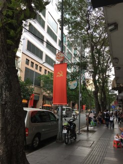 Along with the national flag, the Communist Party of Vietnam hammer and sickle flag is commonly seen too.