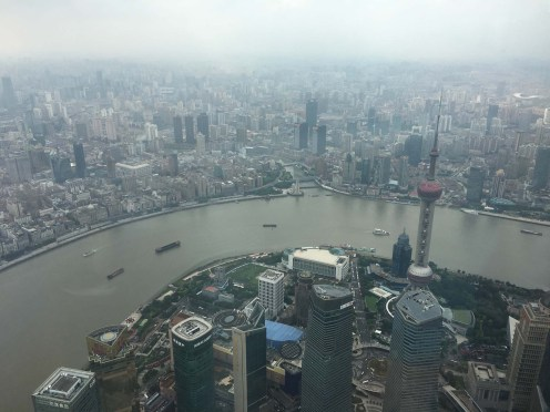 View from Shanghai Tower, 121st floor, highest observation deck in the world at 561 metres (2nd tallest building in Asia). Looking over the Oriental Pearl TV Tower in the Pudong financial district and Huangpu River.