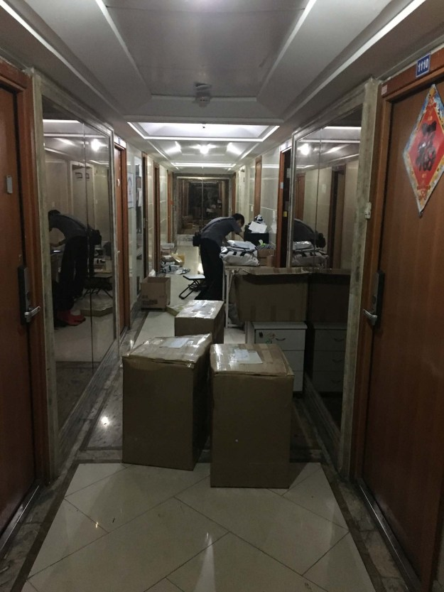People packing boxes throughout the day and night in our building's hallways.