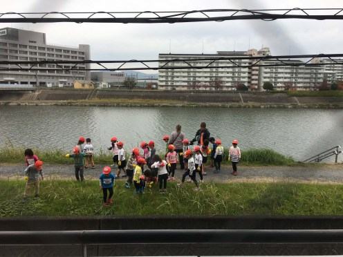 Daily Kindergartners stroll past our window