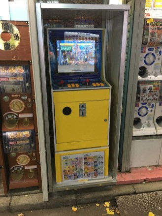 Arcade machine in alley (Akihabara neighborhood)