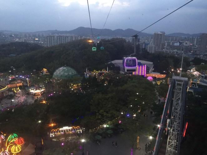 Tram ride across the theme park at dusk.