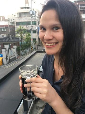 Sarah enjoying her flash-roasted cold press marley-hopped beer.