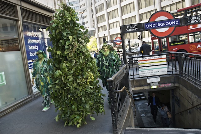 Jack-in-the-Green procession passes Monument underground, London