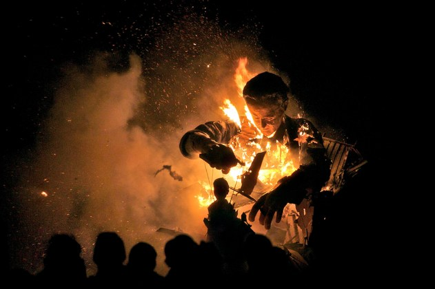 Burning effigies of David Cameron and Nick Clegg, Cliffe Bonfire Society, Lewes, Sussex