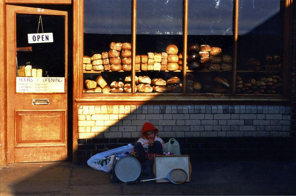 Boy outside Jone's Dairy, Shoreditch, London