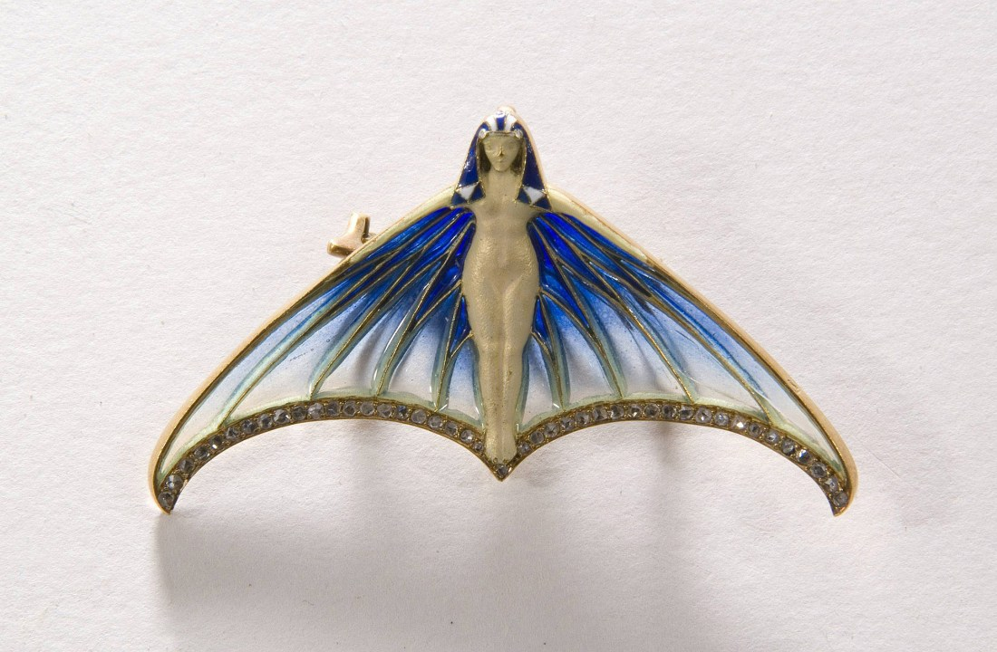 Brooch in the motif of a winged figure. ca. 1900.