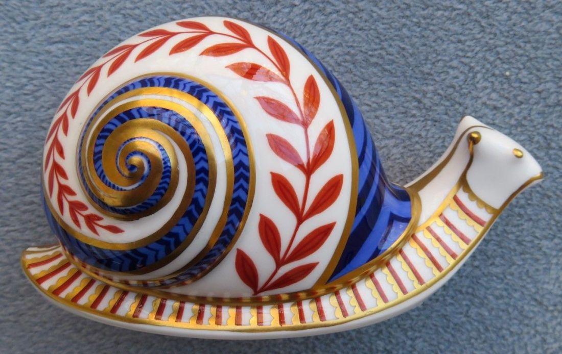 Snail paperweight.