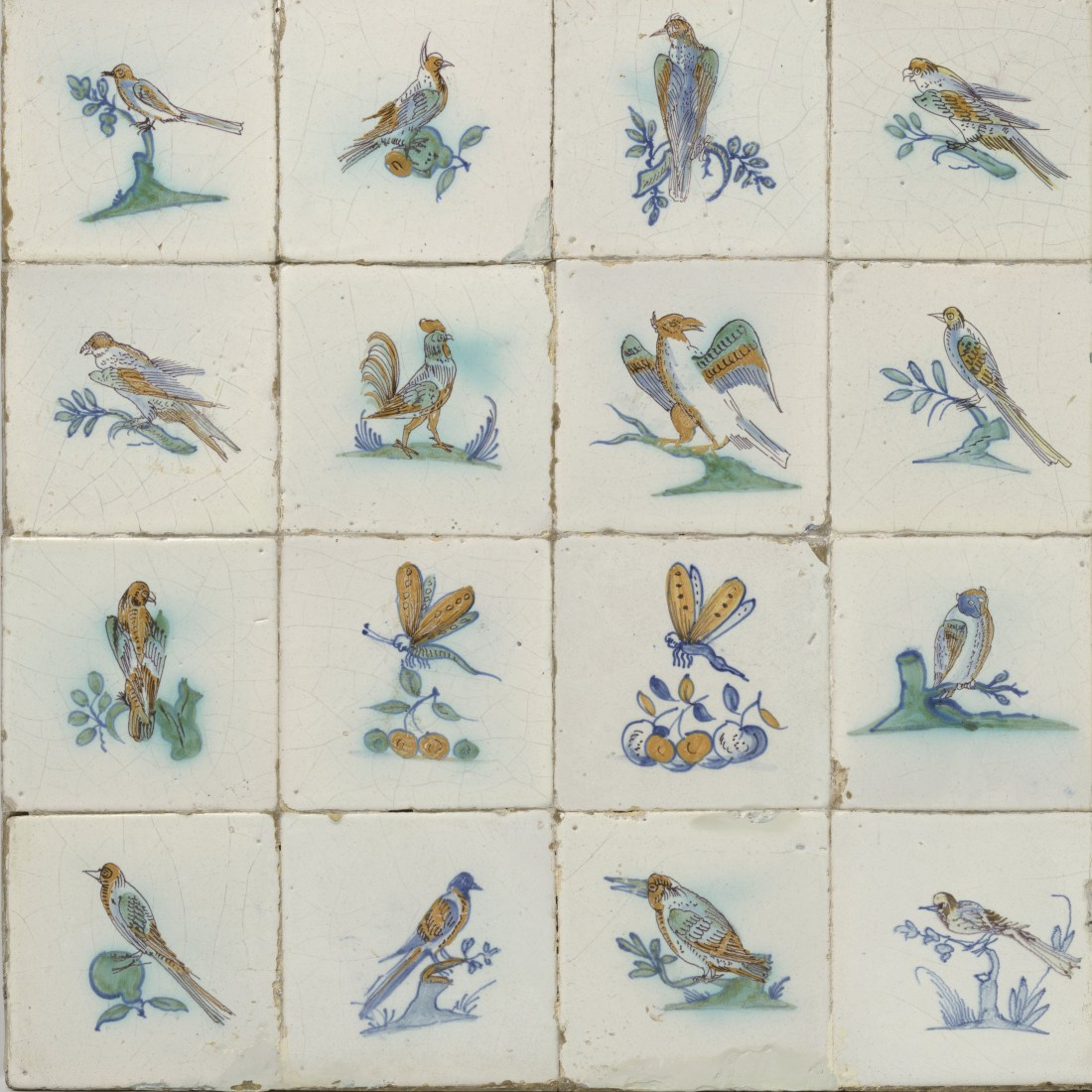 Field of sixteen tiles, each with a painted bird or insect. ca. 1650-1700.