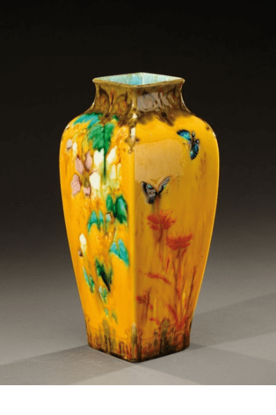 Large ceramic vase decorated with butterflies, birds and floral motifs. 1880-1890.