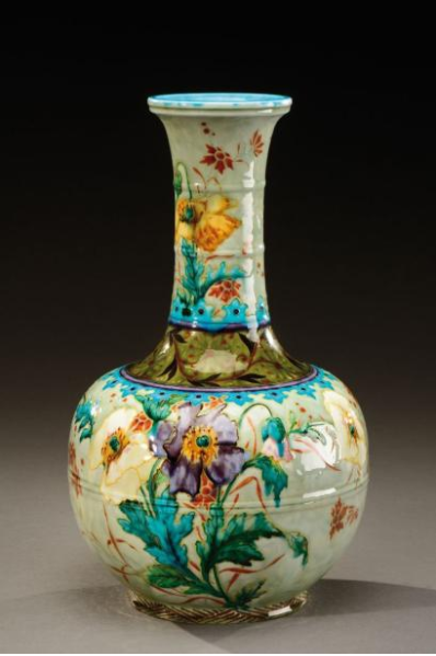 Ceramic vase. Polychrome enamel with floral motifs, butterflies and birds. 1880-1890.
