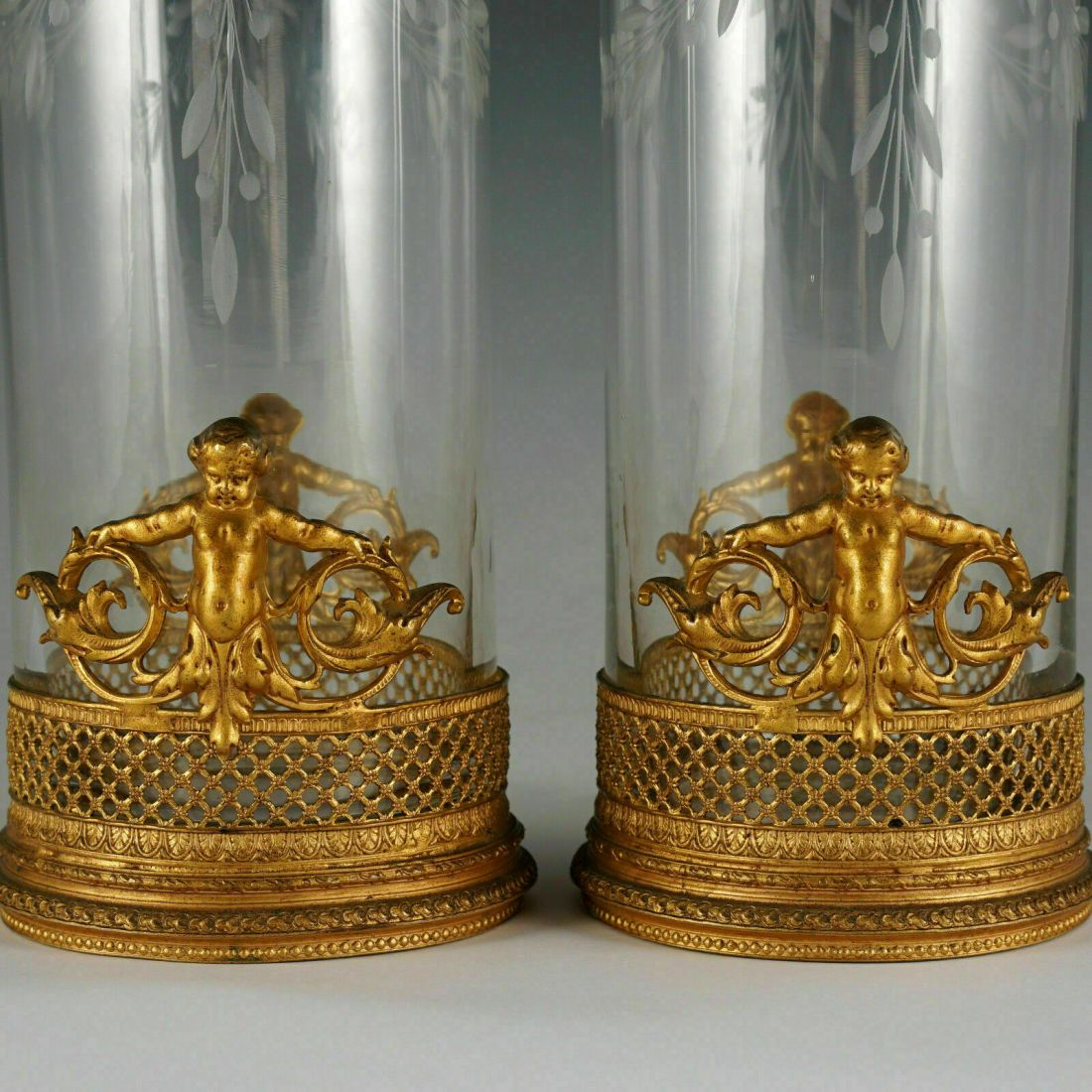 Pair of Empire glass vases with ormolu gilt bronze putti (putti detail). Mid 19th c. French.