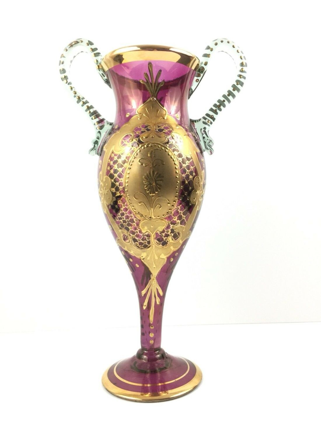 Amethyst jeweled vase with clear glass handles. No date.