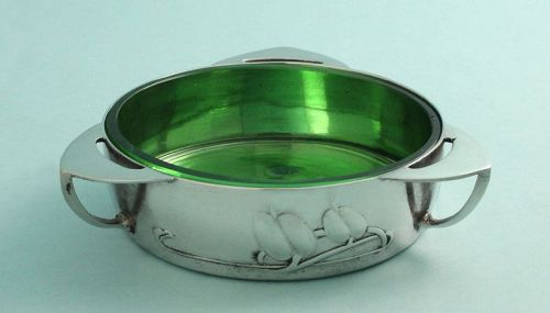 Butter dish. Open tri-handle form with stylized honesty leaves in relief and its original Powell glass liner. ca. 1902-05.