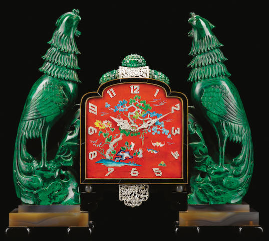 Clock. Case with an orange dial supported by malachite phoenixes. 1920's. Chinoiserie in style.
