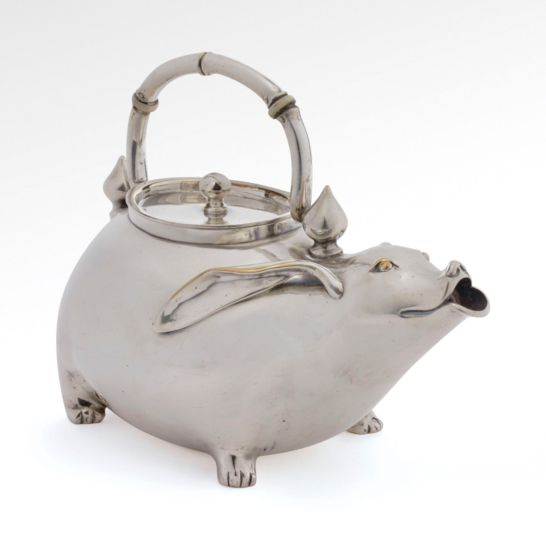 Teapot in the design of a stylized hare, the handle having spinning top attachments and ivory insulators and the cover with a ball grip. Japonisme. 1876-1877. Made in Paris.