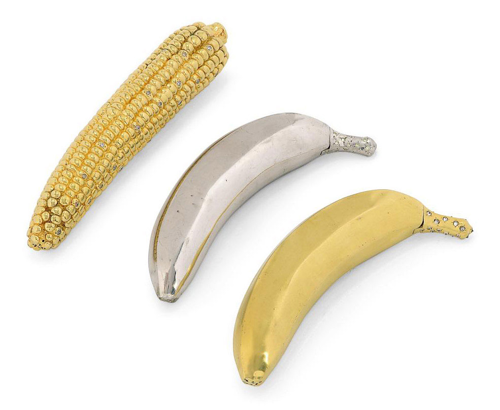 Three novelty pepperettes, two modeled as bananas and the third as an ear of corn. 20th c. Gilt with the ear of corn set with stones.