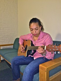 To unwind, Elisa likes to sing and play the guitar, which she taught herself how to do.