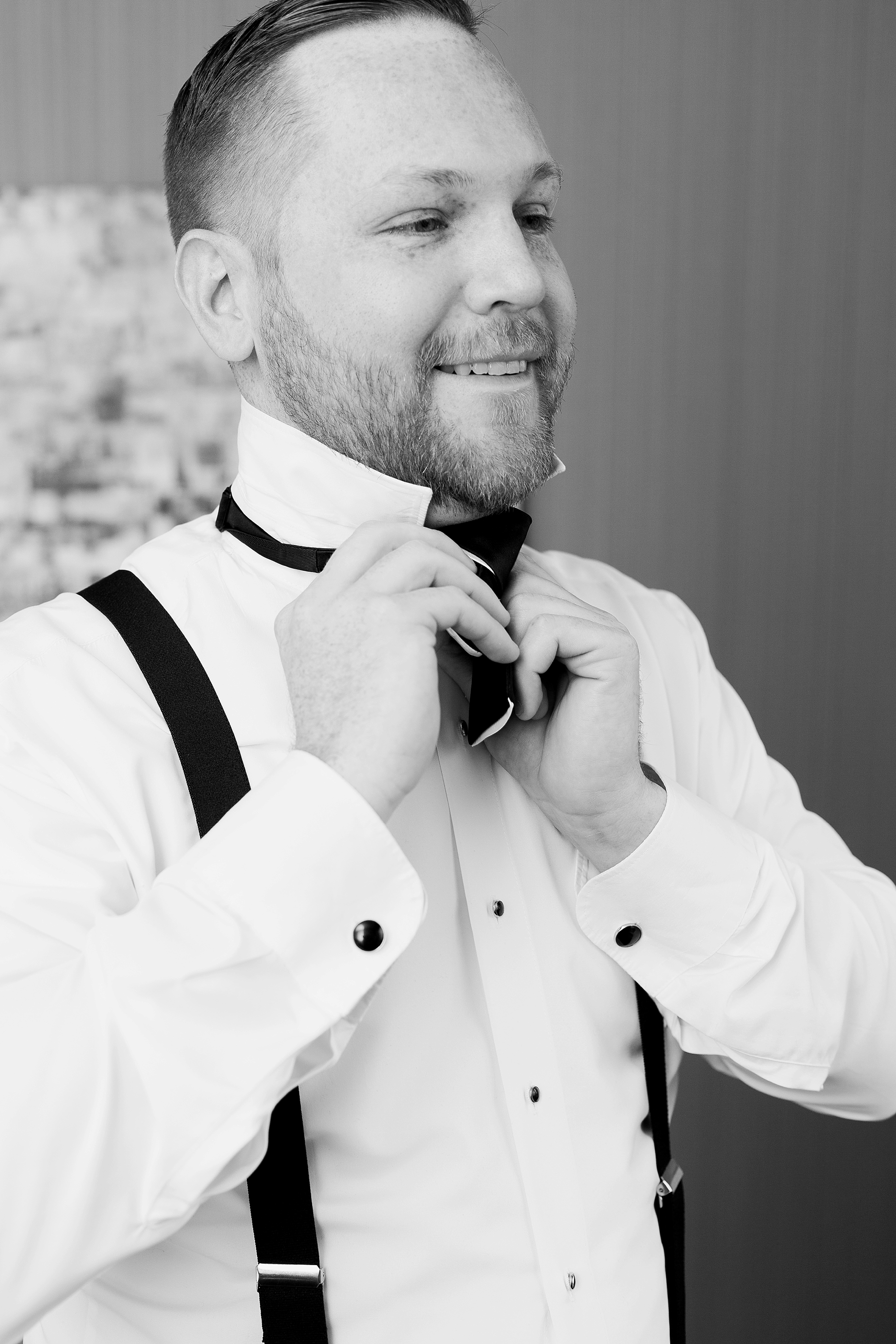 grooms tying his bow tie | William Penn Inn Wedding