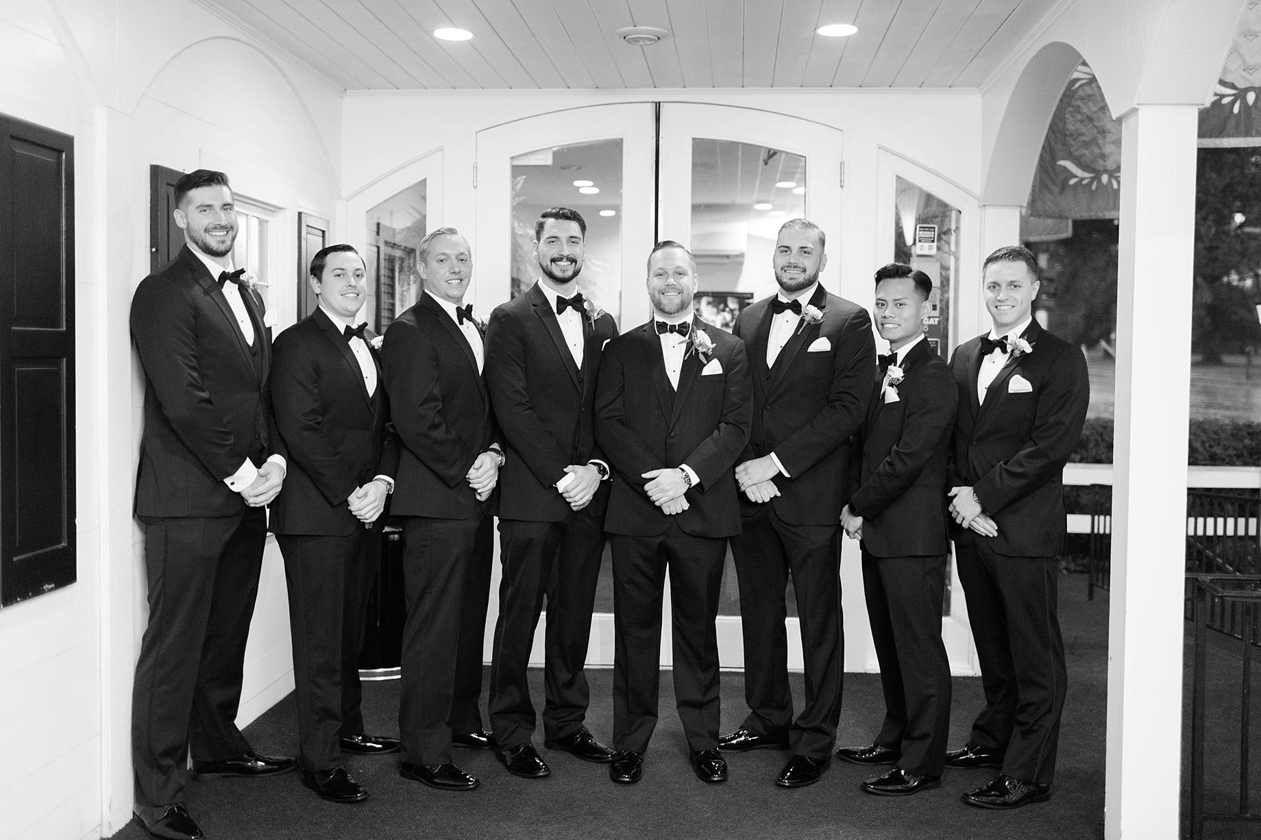 groomsmen in all black tuxes with bowties   William Penn Inn Wedding