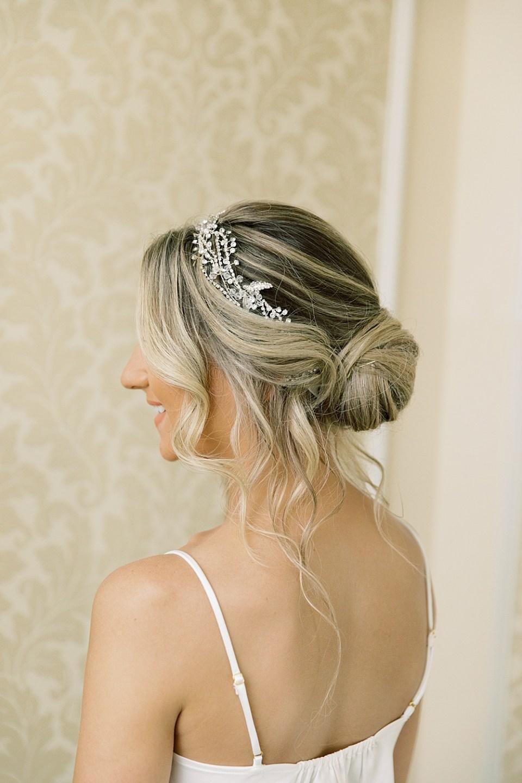 bridal bun with hair piece   sarah canning photography
