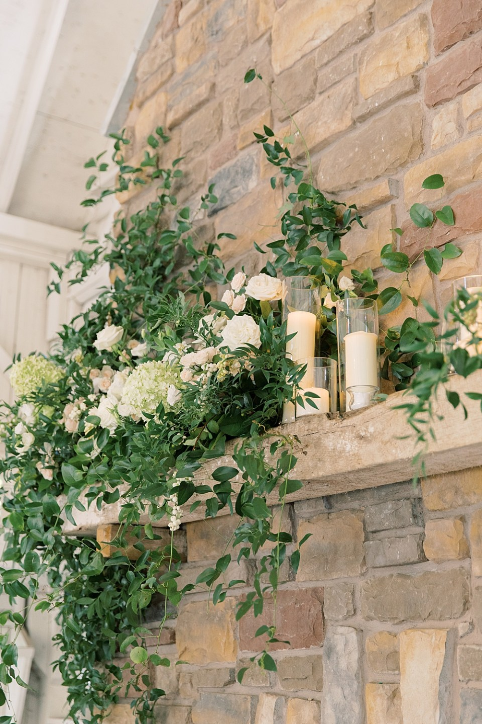 greenery and flowers on the fireplace | wedding decor | whisper + brook flower co | sarah canning photography