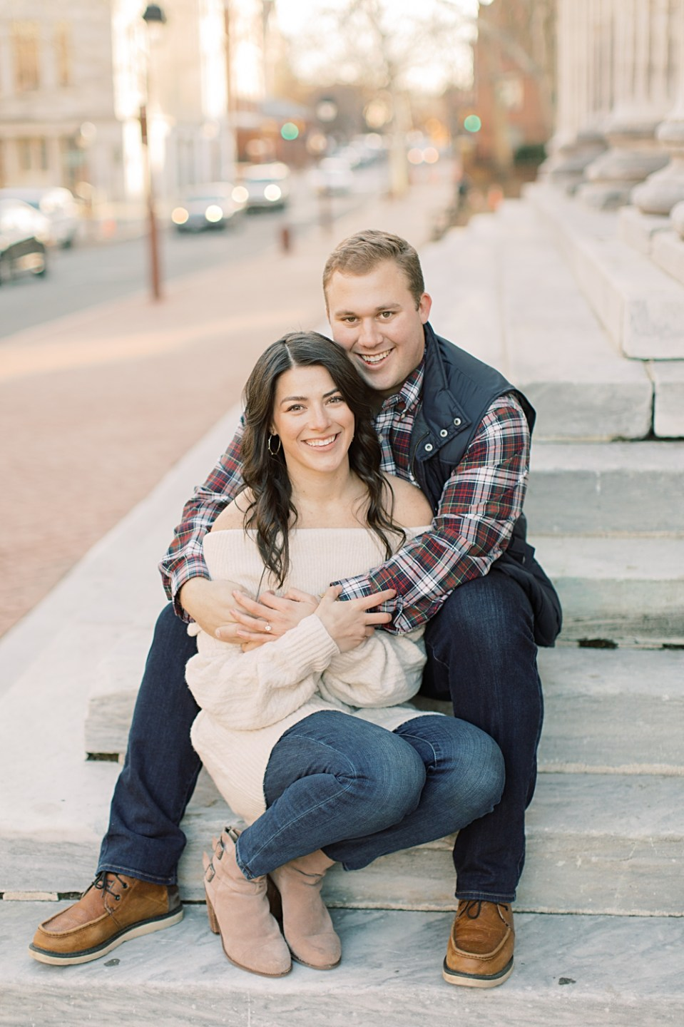 Engaged couple cuddling on steps | Philadelphia Engagement Session
