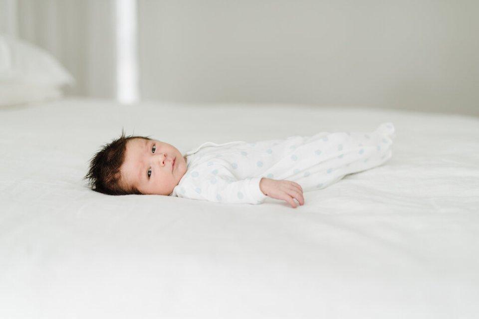 lifestyle newborn photo by Auckland newborn photographer Sarah Clayton