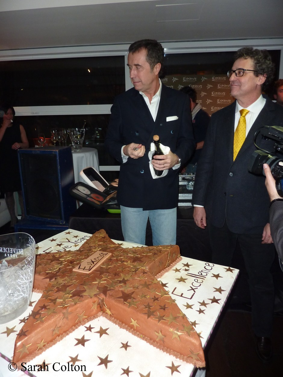 Silvio Levi, and Maurizio Cavezzali cutting the Esxence 5th Anniversary cake at the 'GOLD' party held during the evening of the first day.