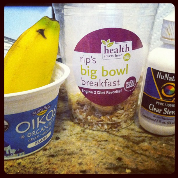 Today's breakfast was a combination of 1/2 a banana, Greek yogurt, stevia to sweeten, and handful of rips big bowl breakfast from WH as a granola alternative! #eatclean #breakfast #whatIeatinaday #inst