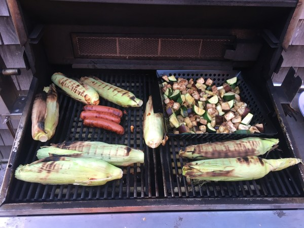 Cook low maintenance corn on the grill but cutting each end and removing a few outer leaves. Place directly on the grill, turn the corn so it's evenly cooked and you've got delicious easy corn!