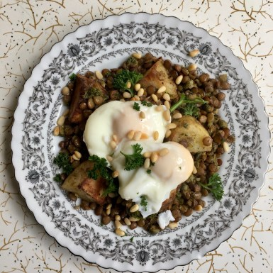 Eggs on lentils with potatoes breakfast