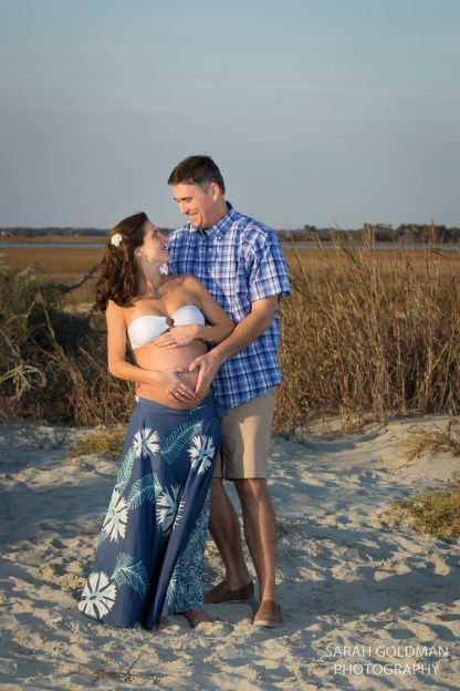 couple at folly beach during pregnancy shoot